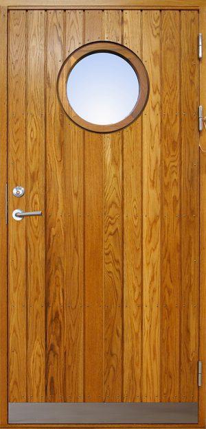 ytterdörr med stående panel och runt glas